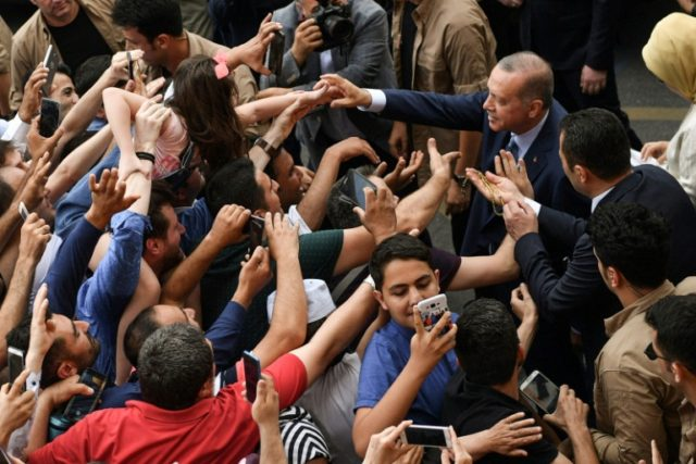 Turkey's President Recep Tayyip Erdogan was greeted by supporters after casting his vote in snap elections