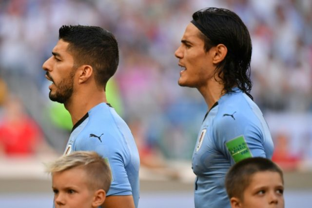 Luis Suarez (left) and Edinson Cavani both scored as Uruguay beat Russia 3-0 to top World Cup Group A
