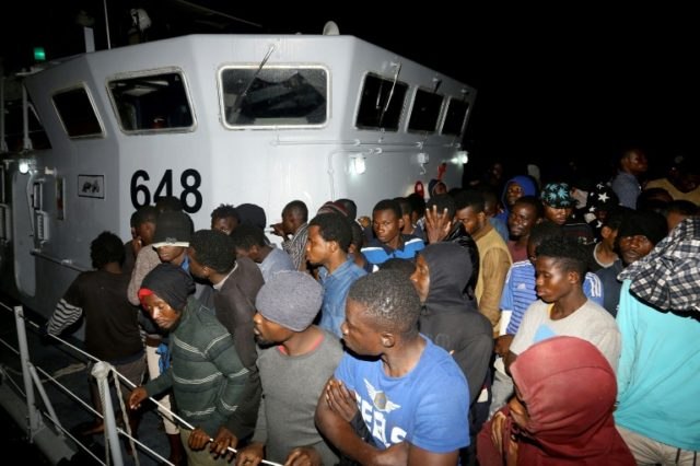 Migrants arrive at a naval base in Tripoli after being rescued in the Mediterranean on June 24, 2018