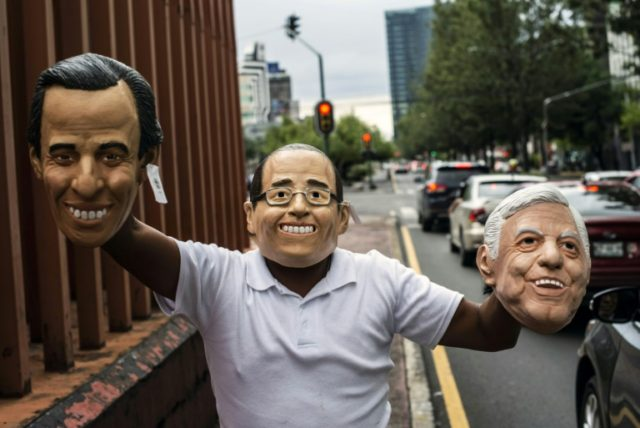 A street vendor offers masks of Mexican presidential candidates (from left) Jose Antonio Meade (PRI, PVEM and Nueva Alianza parties), Ricardo Anaya (PAN-PRD-Movimiento Ciudadano parties) and Andres Manuel Lopez Obrador (Morena, PT and PES parties)