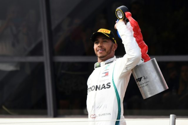 Hamilton holds his trophy after the 65th win of his career having dominated the entire weekend