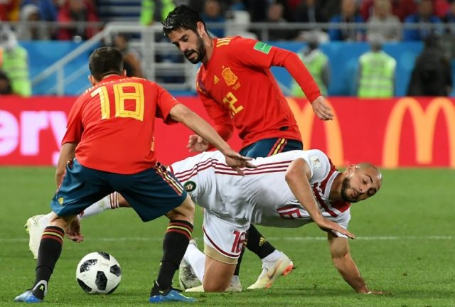 """Spain's midfielder Isco (R) scored in the dramatic 2-2 draw with Morocco, earning the 2010 world champions a last-16 date against Russia which he predicted will be a """"moment of truth"""""""