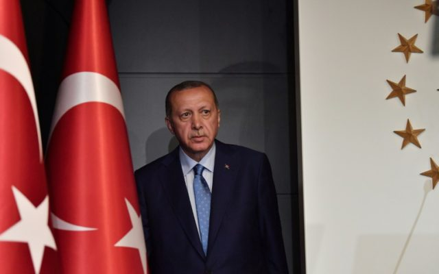 Turkish President Recep Tayyip Erdogan won Sunday's presidential elections in the first round and saw his ruling party-led alliance win an overall majority in parliamentary elections, according to preliminary results