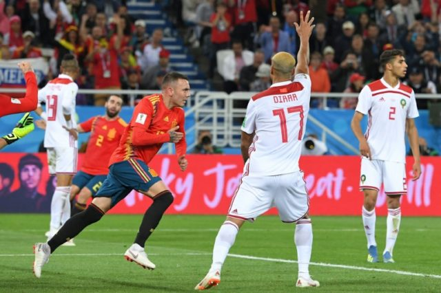 Spain's forward Iago Aspas (3R) celebrates after the VAR (Video Assistant Referee) confirmed his goal during the Russia 2018 World Cup Group B football match between Spain and Morocco