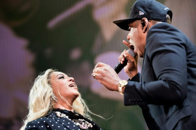 Beyonce (L) and Jay-Z -- seen here at a 2016 event -- were held out of the top of the US album chart by Aussie pop band 5 Seconds of Summer
