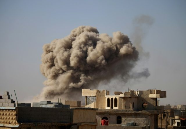 Syrian government forces have seized the strategic rebel-held village of Basr al-Harir, seen here following an air strike on June 24, 2018, as they press a Russian-backed offensive in the south