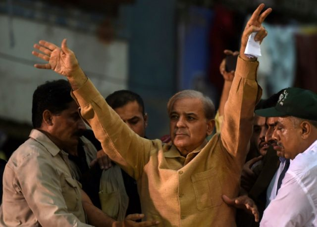 Shahbaz Sharif (C), the younger brother of ousted Pakistani prime minister Nawaz Sharif and the head of Pakistan Muslim League-Nawaz (PML-N), waves to supporters during an election campaign meeting in Karachi