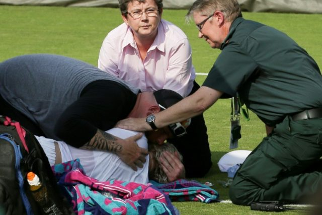 Horror injury: Bethanie Mattek-Sands comforted by her husband Justin Sands after her injury at Wimbledon