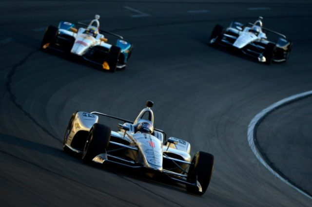 American pole-sitter Josef Newgarden pulled away at the start in capturing Sunday's IndyCar Road America Grand Prix, giving the defending season points champion his 10th career triumph