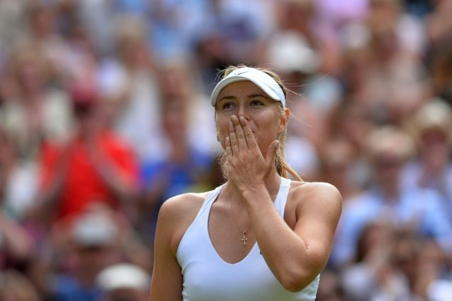 Queen of Centre Court: Maria Sharapova blows a kiss to the crowd on her last appearance at Wimbledon in 2015