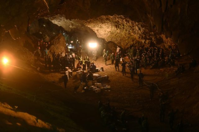 Rescuers worked through the night to try to reach a young football team and their coach who have been trapped inside a Thai cave since Saturday