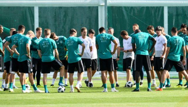 Germany's head coach Joachim Loew (3rd R, in white shirt) instructs his players during a training session in Vatutinki, on June 25, during the Russia 2018 World Cup football tournament