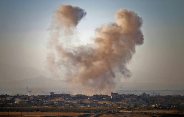 Smoke rises above opposition-held areas of Daraa province during strikes by Syrian regime