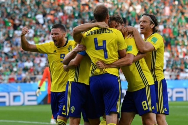 Sweden captain Andreas Granqvist scored his second penalty of the tournament to help his side into the last 16