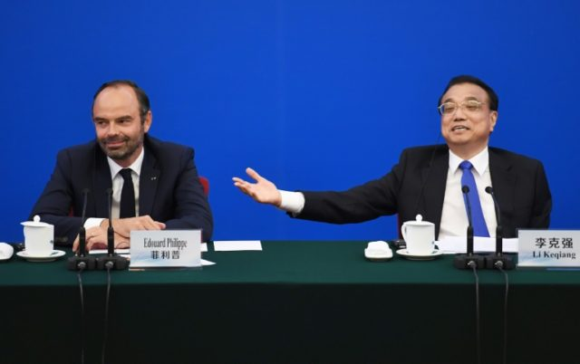 Chinese Premier Li Keqiang (R) speaks during a meeting with France's Prime Minister Edouard Philippe (L) and French business leaders at the Great Hall of the People