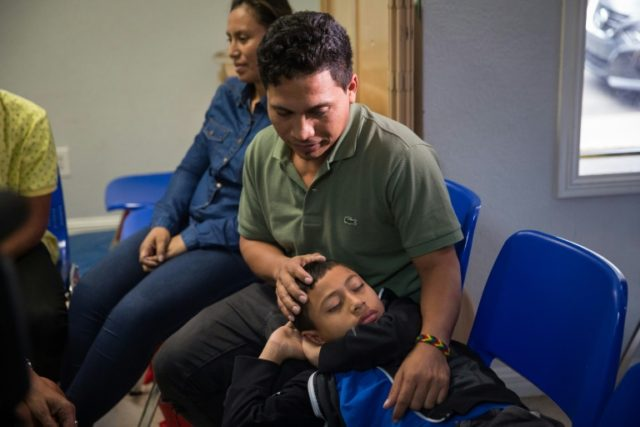 An immigrant from El Salvador and his 10-year-old son spend time together after being released from detention