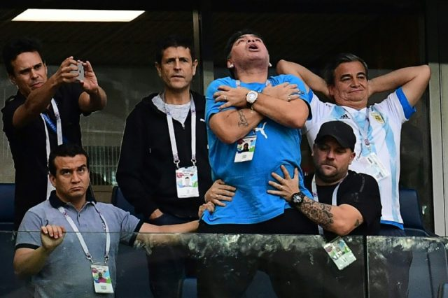 Diego Maradona became increasingly agitated during Argentina's 2-1 win over Nigeria that saved their World Cup