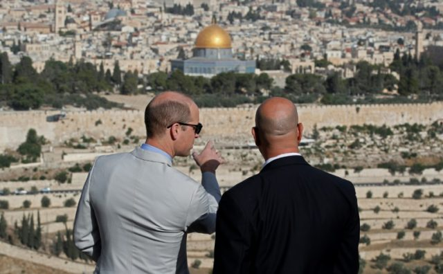 Britain's Prince William talks with a guide as he surveys Jerusalem's flashpoint Al-Mosque mosque compound and its golden-topped Dome of the Rock on June 28, 2018