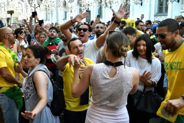 Brazil fans cheer on Nikolskaya street in Moscow which has become the scene of a daily street party