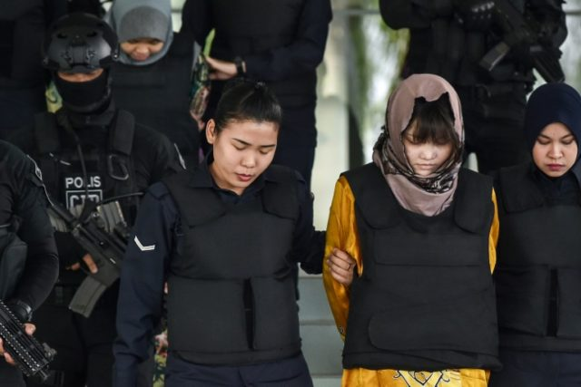 Indonesian Siti Aisyah (back left) and Vietnamese Doan Thi Huong (front right) allegedly killed Kim Jong Nam by smearing the toxic nerve agent VX on his face at a Kuala Lumpur airport last year in a Cold War-style hit that shocked the world