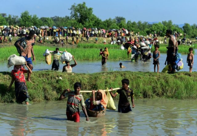 The Trafficking in Persons Report downgraded Myanmar to its worst tier for failing to protect Rohingya Muslims fleeing a military crackdown in Rakhine state