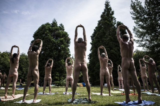Naturists practice yoga in the Bois de Vincennes on the outskirts of Paris
