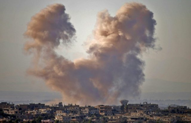 Smoke rises above a rebel-held area of southern Syria during a government air strike on Daraa province on June 27, 2018