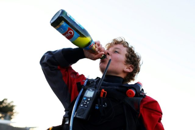 French 12 years old Tom Goron uncorked a bottle of sparkling apple juice to celebrate his Channel crossing in Cherbourg, northwestern France
