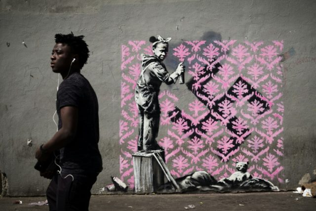 Banksy made headlines with a Paris mural of a refugee child covering up a swastika sprayed over the patch of pavement on which she was sleeping