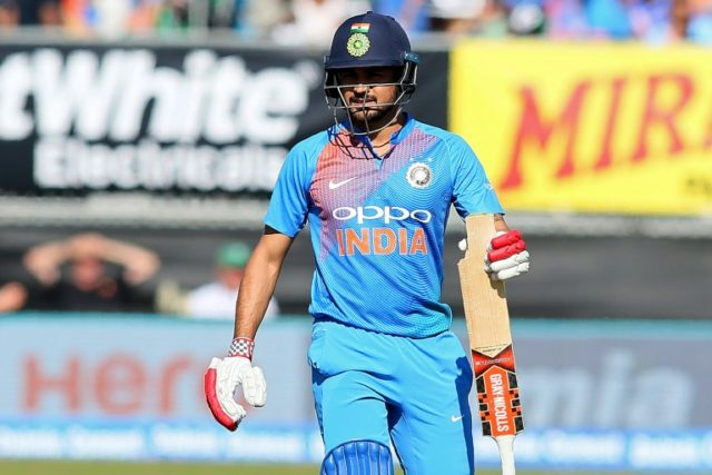 Power-packed: India's Manish Pandey breaks a piece off his bat during his innings