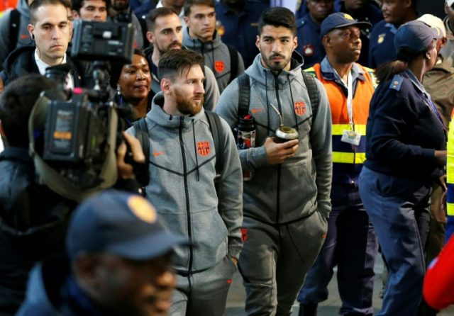 Barcelona team-mates Lionel Messi and Luis Suarez arrive at Johannesburg's Oliver Tambo airport on in May 2018