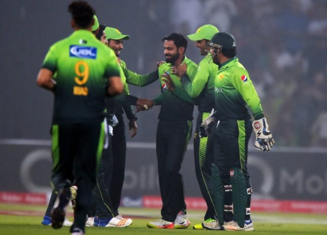 Pakistani spinner Mohammad Hafeez (C) celebrates with teammates after the dismissal of a Sri Lankan cricketer during a T20 match in Lahore, in October 2017