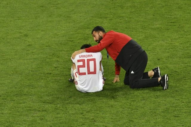 Iran striker Sardar Azmoun, seen here being consoled after the team narrowly missed out on making the World Cup's last 16 at Portugal's expense, has announced he is retiring from international football because of the toll on his mother's health