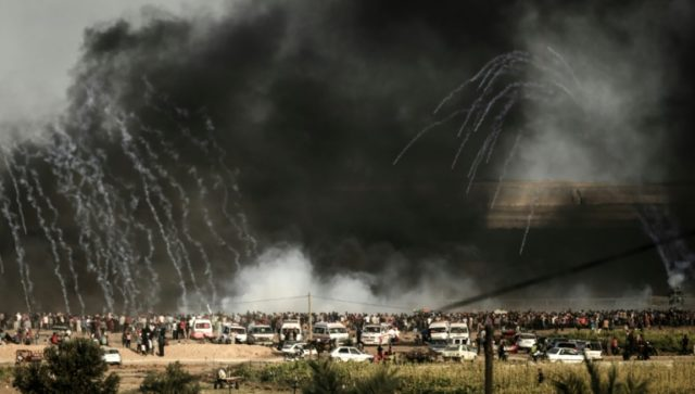 Israeli forces shoot tear gas at demonstrators along the border between the Gaza Strip and Israel on June 29, 2018