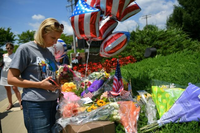 Christine Feldmann placed flowers at a makeshift memorial for victims of a shooting at an Annapolis, Maryland newsroom