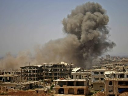 Smoke rises above opposition held areas of the city of Daraa during air strikes by Syrian regime forces on June 28, 2018