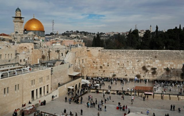 A general view shows the Western Wall (R) and the Dome of the Rock (L) in the Al-Aqsa mosque compound in the Old City of Jerusalem on December 5, 2017