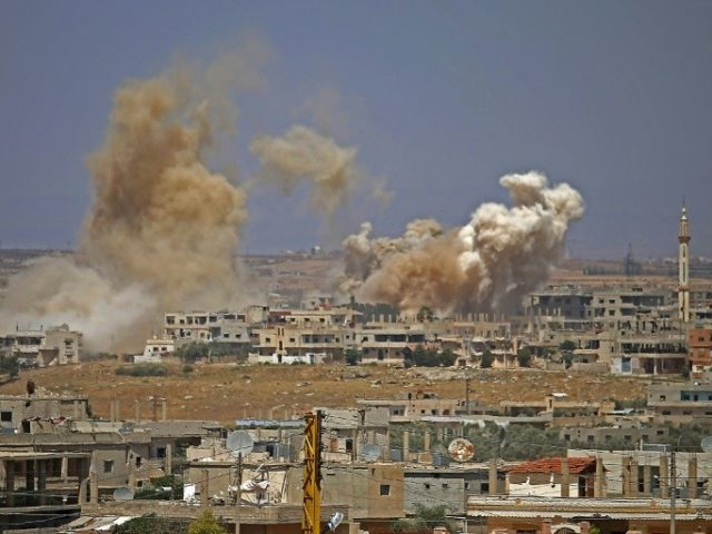 Smoke rises above rebel-held areas of Daraa city during airstrikes by Syrian regime forces on June 29, 2018