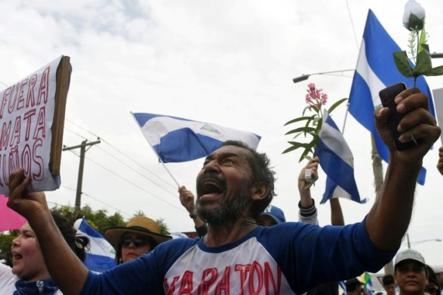 At least two dead in Nicaragua's day of anti-Ortega marches