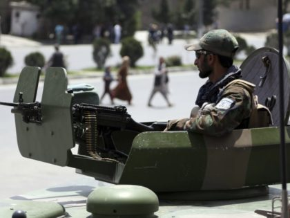 Afghan security personnel arrive at the site of suicide attack in Kabul Monday, June 4, 2018. A suicide bombing targeted a gathering of Afghanistan's top clerics on Monday in Kabul, killing at least seven people and wounding nine. (AP Photo/Rahmat Gul)