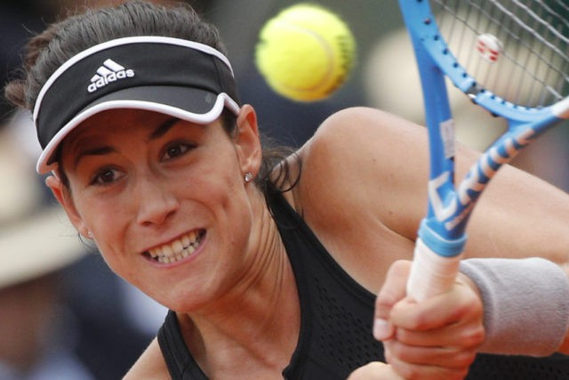 Muguruza, Halep set up French Open semifinal; Nadal in limbo