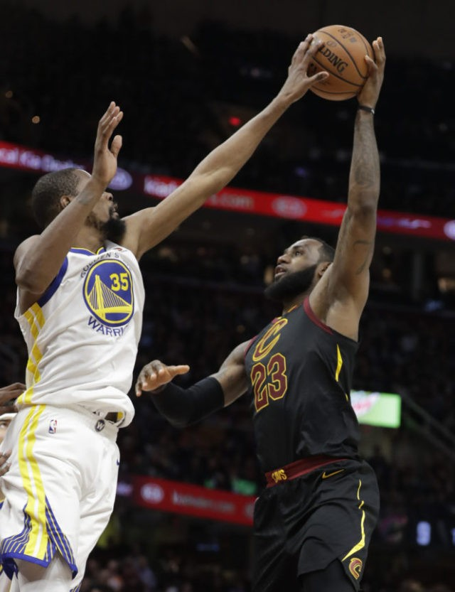 The Latest: Durant, Warriors trying to hold off Cavaliers
