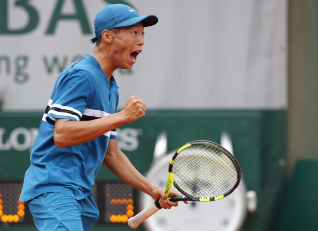 The Latest: Tseng wins boys' title in Paris
