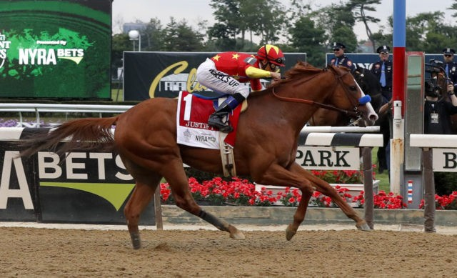 The Latest: Justify captures Triple Crown, wins Belmont