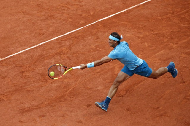 The Latest: Nadal wins 1st set of French Open final