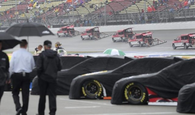 The Latest: Bowyer wins rain-shortened race at Michigan