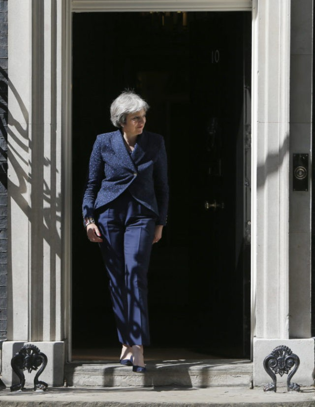UK's May pleads for Conservative unity on Brexit votes