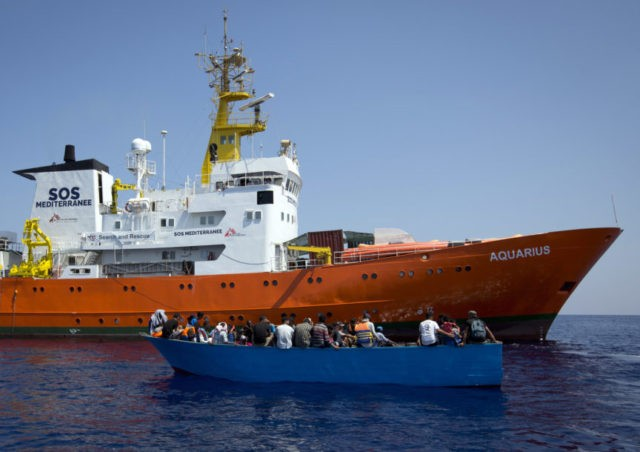 The Latest: Migrant rescue ship faces hurdles reaching Spain