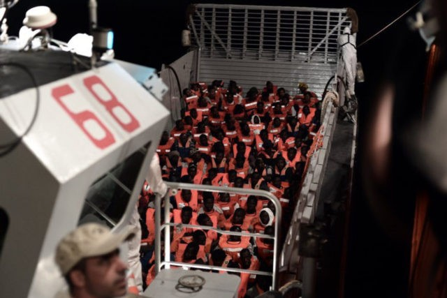 Migrant boat low on food as Italy-Malta standoff escalates
