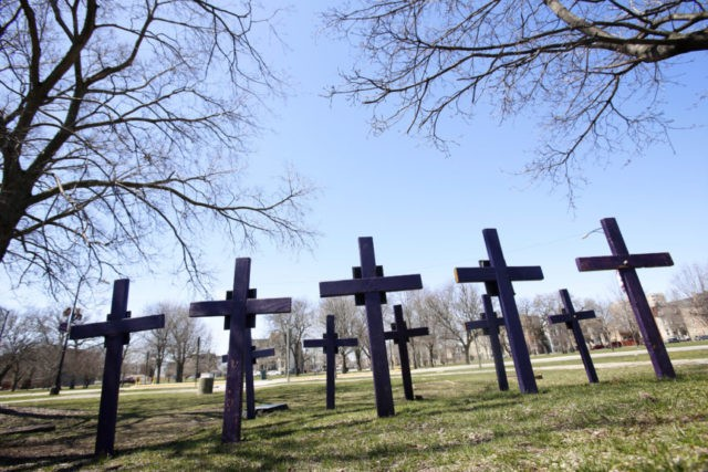 In this Thursday, April 19, 2018 file photo, crosses representing victims of gun violence stand outside Collins Academy High School in Chicago's North Lawndale neighborhood. With frustration mounting over lawmakers' inaction on gun control, the American Medical Association on Tuesday, June 12, 2018, pressed for a ban on assault weapons …